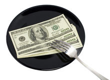 Dollars on black plate Royalty Free Stock Photography
