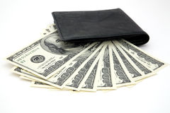 Dollars and black purse Royalty Free Stock Images