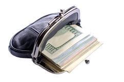 Dollars in black purse white background. Stock Images
