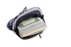Dollars in black purse white background. Royalty Free Stock Photo
