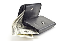 DOLLARS IN A BLACK WOMEN'S PURSE. On a white background Stock Photo