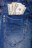 Dollars in blue jeans pocket Royalty Free Stock Photos