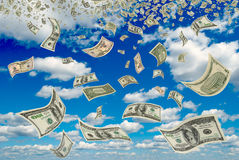Dollars in the blue sky. Royalty Free Stock Image
