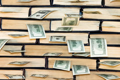 Dollars in the books. Background from old books   with the money. Wall of Books Royalty Free Stock Photos