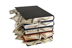 Dollars in the books Royalty Free Stock Photos