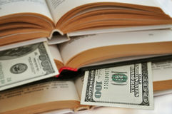 Dollars in books Stock Photo