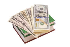 Dollars on the Books Royalty Free Stock Photo
