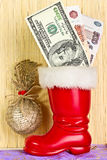 Dollars in boot of Santa Claus. Dollars and rubles in boot of Santa Claus. Christmas decoration Royalty Free Stock Photography