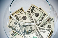 Dollars in a bottle Stock Photography