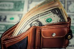 Dollars in wallet on soft money. close up. stock image