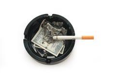 Dollars brûlants Photographie stock libre de droits