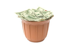 Dollars in brown basket Stock Images