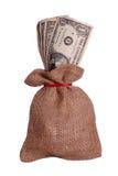 Dollars in bruine zak Stock Afbeeldingen