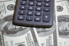 Dollars and calculator Stock Image