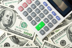 Dollars and calculator Stock Photos