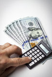 Dollars and calculator Stock Images