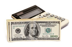 Dollars and calculator Royalty Free Stock Images