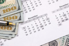Dollars with calculator on the calendar Royalty Free Stock Image