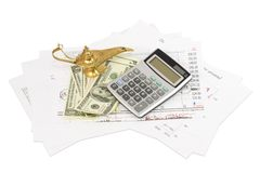 Dollars, calculator, graphics and lamp of Aladdin Stock Photography