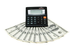 Dollars and calculator isolated Royalty Free Stock Photos
