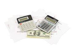 Dollars, calculator and paper charts Stock Image