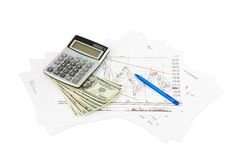 Dollars, calculator and paper charts Stock Photos