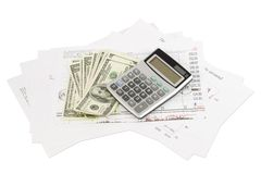Dollars, calculator and paper charts Royalty Free Stock Photos