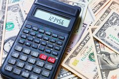 Dollars and calculator Royalty Free Stock Photography