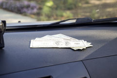 Dollars on a car dashboard under the windshield. American Money Royalty Free Stock Photography