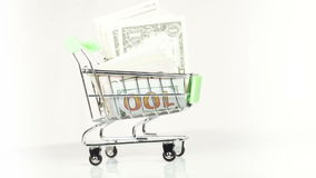 Dollars in cart stock video footage