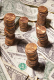 Dollars and Cents. Pennies stacked on dollar bills Stock Photos