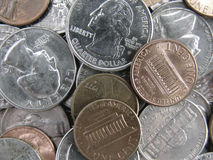 Dollars and cents. Close up of spare change - nickels, dimes, quarters, pennies stock image
