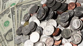 Dollars and cents rotating stock video footage