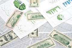 Dollars and charts Royalty Free Stock Images