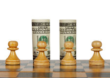 Dollars on the chess board. Isolated on white Royalty Free Stock Photos