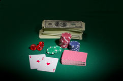 Dollars chips cards and dices Stock Photography