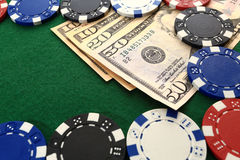 Dollars and chips on green casino table closeup Royalty Free Stock Photos