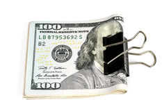 Dollars clamped by a terminal clothespin. Money squeezed by a terminal clothespin Royalty Free Stock Images
