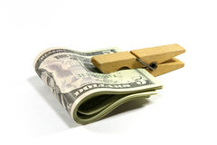 Dollars clip. Dollars and wooden linen clothespin Royalty Free Stock Photos