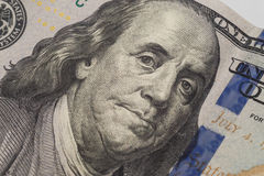 Dollars closeup. Benjamin Franklin`s portrait on new one hundred dollar banknote. Stock Image