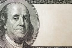 Dollars closeup. Benjamin Franklin`s portrait on one hundred dollar bill with copy space.  Royalty Free Stock Photography