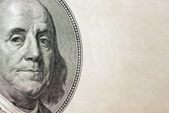 Dollars closeup. Benjamin Franklin`s portrait on one hundred dollar bill with copy space.  Stock Photos