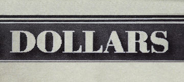 Dollars closeup text. Dollars macro closeup text from a money note Stock Photography