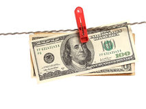 Dollars on clothes-peg Stock Images