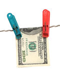 Dollars on clothes-peg Stock Photos