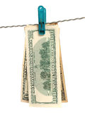 Dollars on clothes-peg Stock Photo