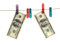 Dollars on clothes-peg Royalty Free Stock Images