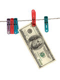 Dollars on clothes-peg. Over white stock image