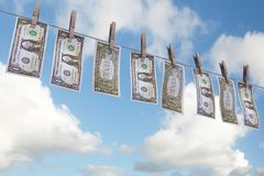 Dollars on clothesline Stock Photos