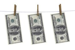 Dollars on the clothespin Royalty Free Stock Image